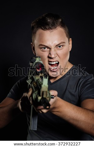 rebel with rifle on black background - stock photo