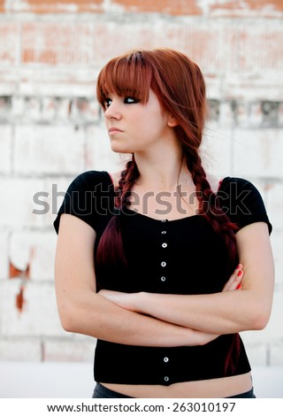 Rebellious teenager girl with red hair very angry - stock photo