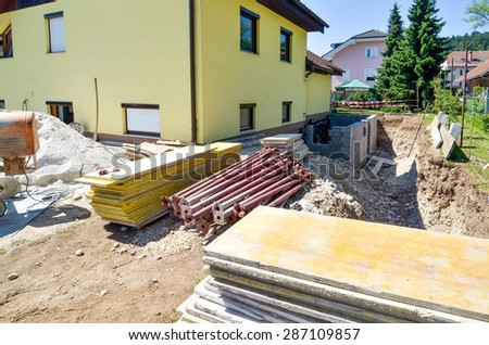 Rebuilding a family house and adding an  extension. Setting up a construction site. - stock photo
