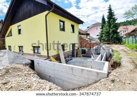 Rebuilding a family house and adding an extension. Setting up a construction site with formwork.. - stock photo