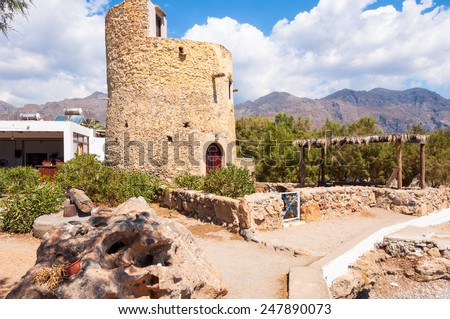 Rebuilt former windmill in the resort Frangokastello, on the southwest coast of Crete. The Village is known by the venetian fortress close to the Mediterranean sea. - stock photo