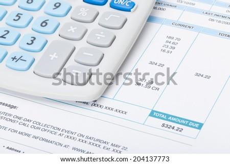 Receipt next to calculator - studio shot - stock photo