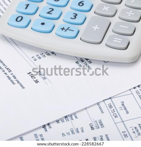 Receipt next to neat calculator - stock photo