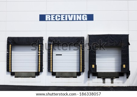 Receiving - the warehouse with white gates. - stock photo