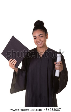 Recent college graduate in a cap and gown - stock photo