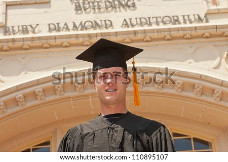 Recent FSU graduate poses in front of the Westcott Building on the Campus of Florida State University in Tallahassee, Florida. - stock photo