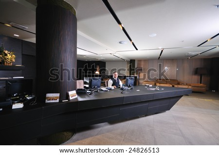 reception service man hotel indoor smile travel - stock photo
