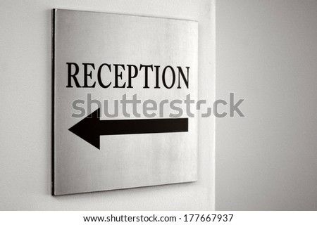 Reception sign with direction arrow. (BW) - stock photo