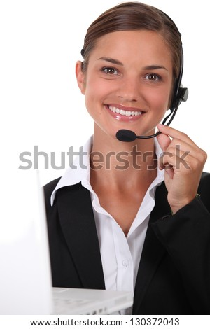 Receptionist with headset and computer - stock photo