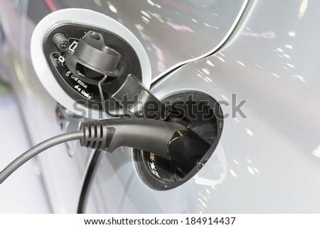 Recharging an electric car - stock photo