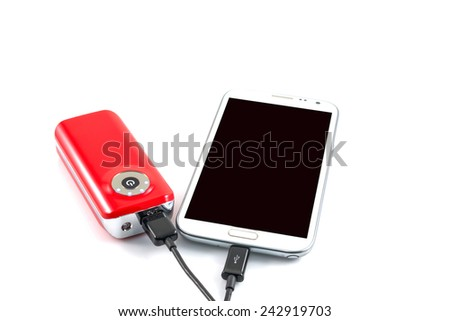 Recharging smart phone tablet from power bank, electricity's source portable on withe background. - stock photo
