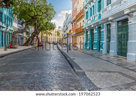 RECIFE, BRAZIL - APRIL 12: Panorama of the architecture of the historic Bom Jesus Street in Recife, PE, Brazil with its buildings and cobble stones dated from the 17th century on April 12, 2014. - stock photo
