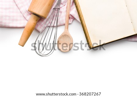 recipe book and kitchen utensils on white background - stock photo