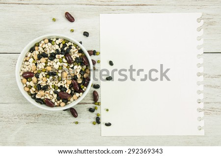 Recipe paper and cereal Grains on wood table. - stock photo