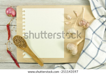 Recipe paper on white wooden table. - stock photo