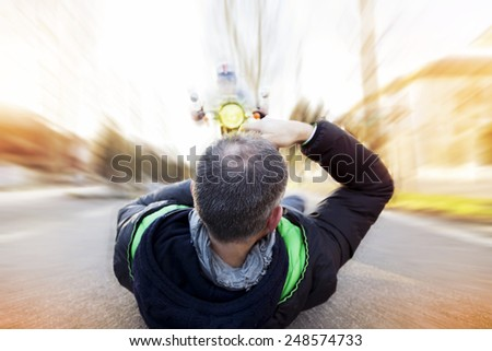 reckless photographer shooting a motorcyclist w - stock photo