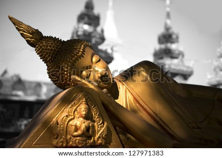 Reclining Buddha at the temple in Vientiane. - stock photo