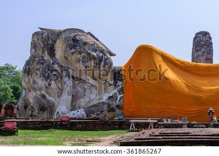 Reclining buddha at Wat Lokkayasutharam in Phra Nakhon Si Ayutthaya, Thailand. - stock photo
