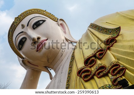 Reclining Buddha in Northern Thailand. - stock photo
