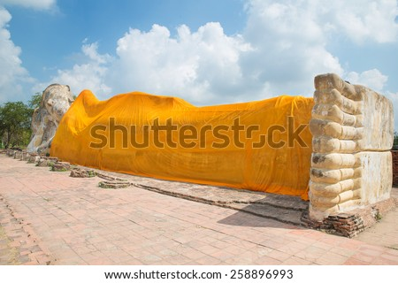 Reclining Buddha of Wat Lokayasutha in Ayutthaya, Thailand. - stock photo