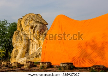 Reclining Buddha statue in temple. Ayutthaya, Thailand. - stock photo
