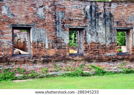 Reclining Buddha statue of Wat Puttaisawan in Ayutthaya, Thailand - stock photo