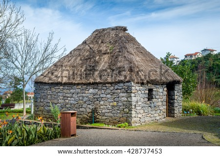 Reconstruction of old traditional stone house of Madeira. Historical and culture park at Santana. Madeira island, Portugal. - stock photo