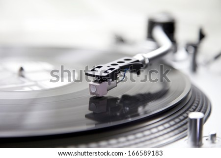 Record Player with a Vinyl for a Dj for Entertainment. The turntable is turning a vinyl with music sound. - stock photo