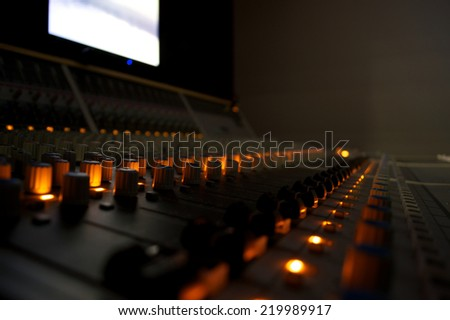 Recording Studio Mixing Desk Controls and Lights - stock photo