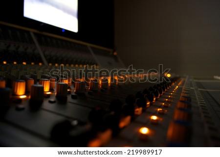 Recording Studio Mixing Desk Controls and Lights - stock photo