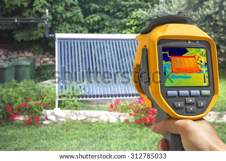 Recording Vacuum solar water heating system With Thermal Camera  - stock photo