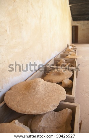 Recovered potshards and clay items from the archeological digs in Al Zubarah, Qatar - stock photo