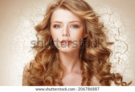 Recovery Concept. Woman with Curly Hair over Cracked Dried Wall (Earth) - stock photo