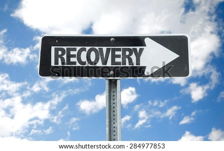 Recovery direction sign with sky background - stock photo