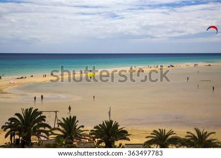 Recreation on beach with lagoon; La Barca, near Costa Calma, Jandia, Fuerteventura, Canary Islands, Spain - stock photo