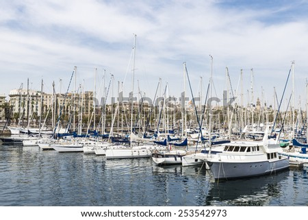 Recreational craft and sailboats in the harbor of Barcelona called Port Vell - stock photo