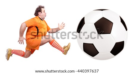 recreational fat football player kicking the ball isolated on a white background - stock photo