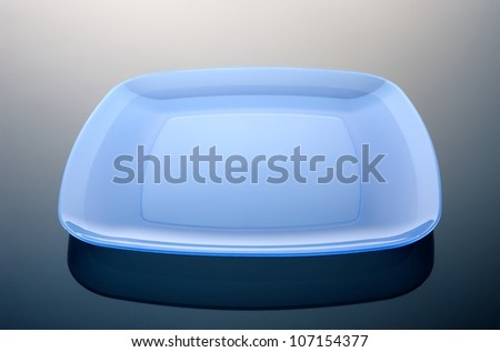 Rectangular plate on a dark reflective surface - stock photo