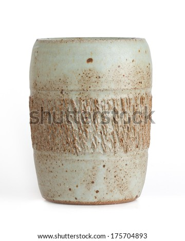 rectangular shaped  vase with scored middle section. mint green and brown colored. white background - stock photo