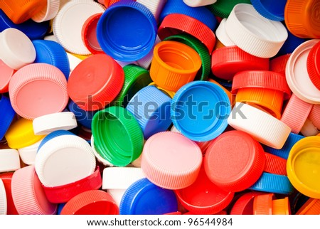 recyclable colorful plastic caps background - stock photo