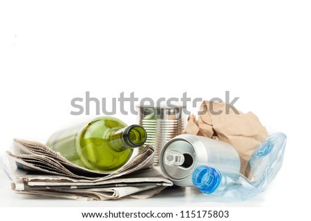 Recyclable materials on white background - stock photo