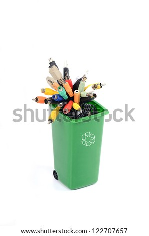 Recycle Bin filled with electronic waste , recycling electronics, recycling e-waste - stock photo