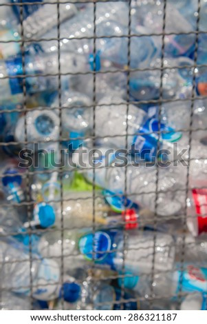 recycle bin filled with plastic bottle blurry filter - stock photo