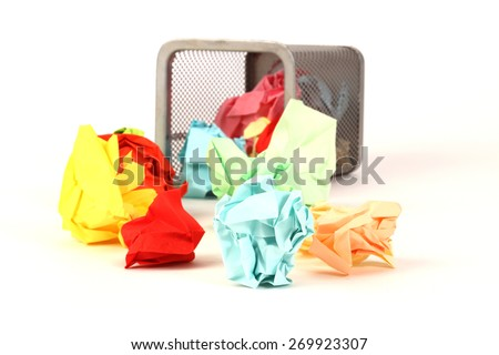 recycle bin with colorful paper waste on white background - stock photo