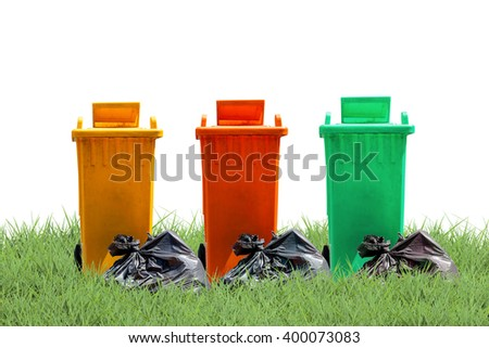 recycle bins and bag garbage on green grass  background ,ecology concept - stock photo
