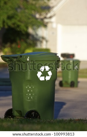 Recycle bins on the curb on residential street - stock photo