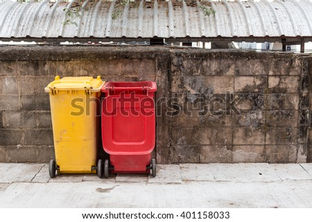 recycle bins with old cement wall - stock photo