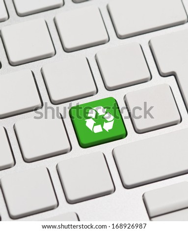 Recycle concept on green keyboard button - stock photo
