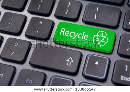 recycle concepts, with a message on enter key of keyboard. - stock photo