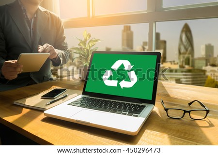 Recycle Green bio eco forest saving environment harmony ecosystem conservation csr esg campaign Thoughtful male person looking to the digital tablet screen, laptop screen,Silhouette and filter sun - stock photo